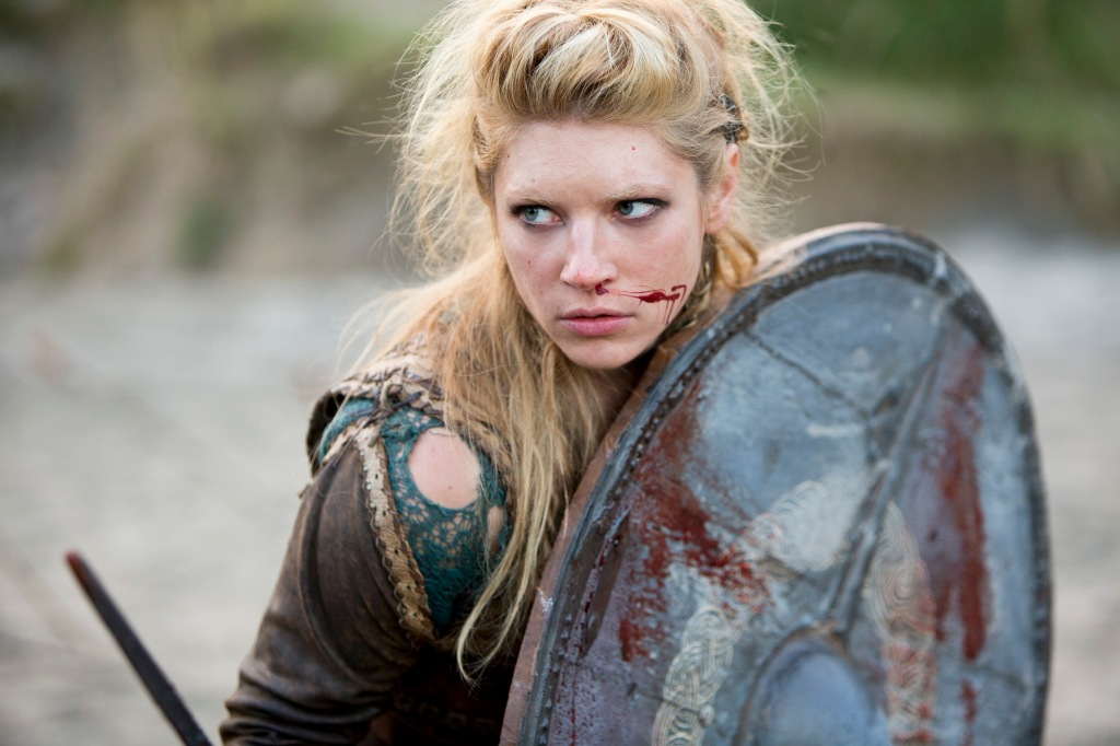 Lagertha holding a circle shield with blood coming from her nose