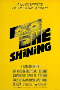 Original movie poster for The Shining, a yellow background with a horrified face in the letters of the title
