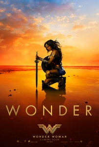 Poster of Wonder Woman kneeling on a beach with a sword and shield
