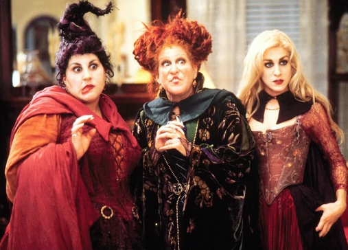 The three Sanderson Sisters looking confused by the modern day.