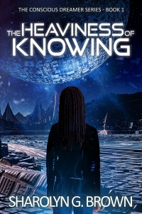 A black woman in a jumpsuit with dreaded hair stands in front of a panorama of futuristic pyramics